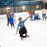 child ice skating