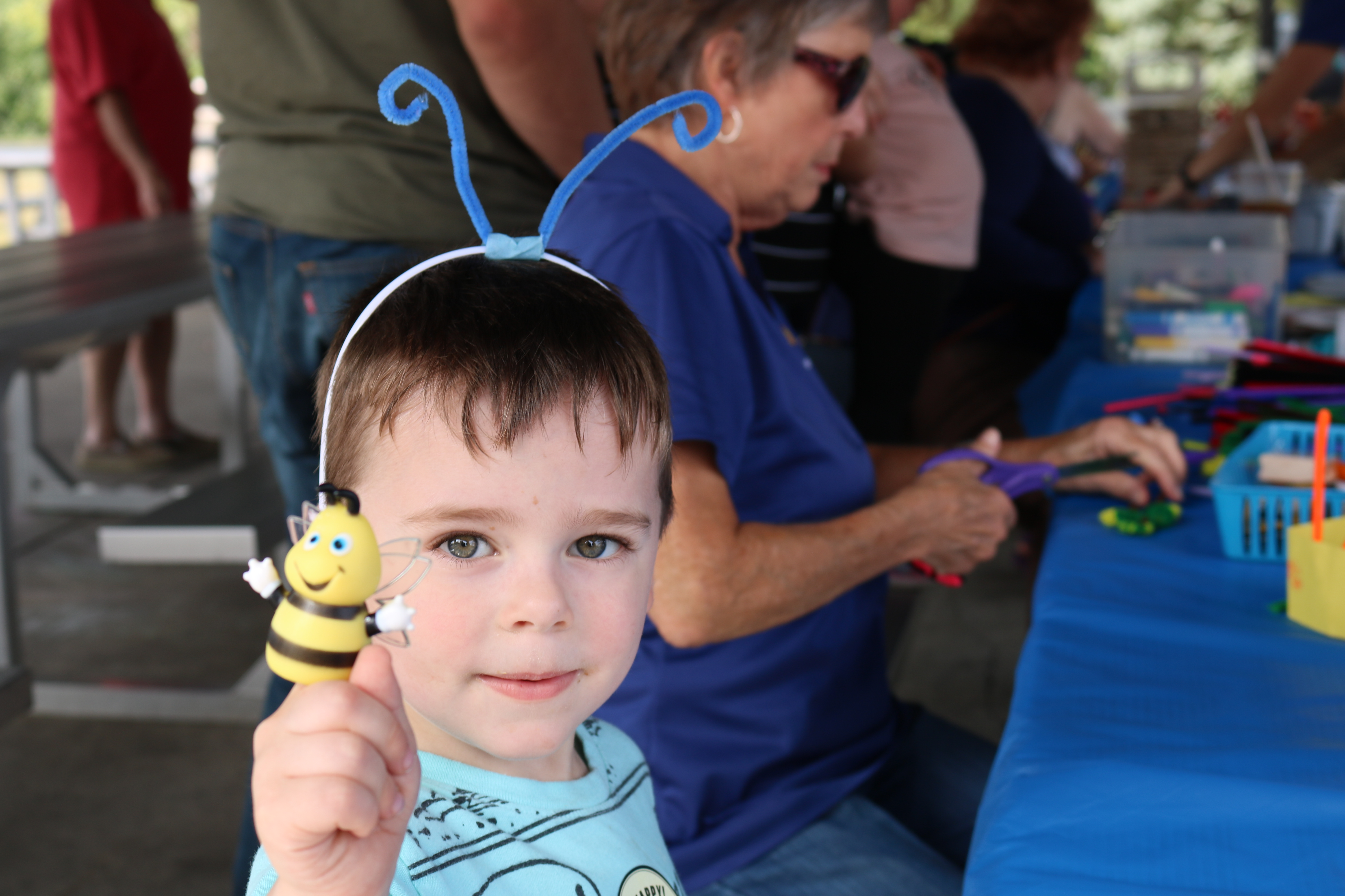 child with bee