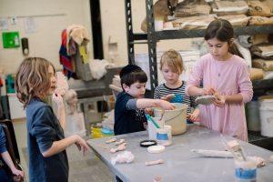 kids making pottery