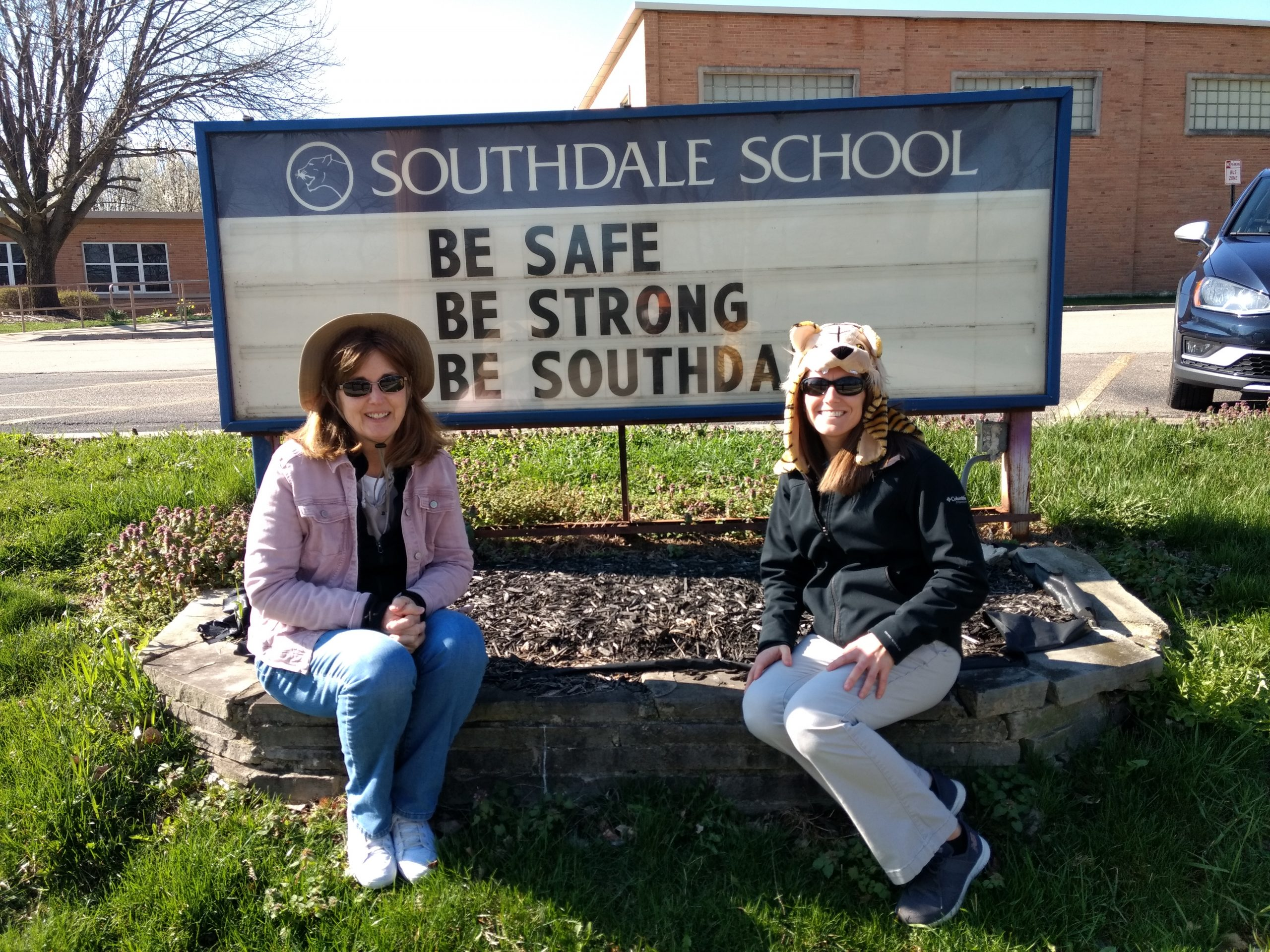 staff with school sign