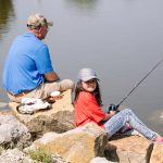 grandparent and child fishing