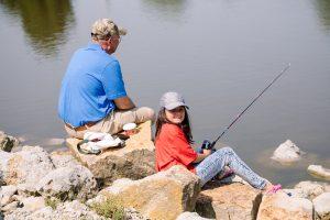 grandparent and child fishing