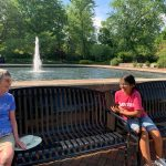 grandmother and granddaughter on bench