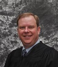 Honorable Judge Denton Lessman
