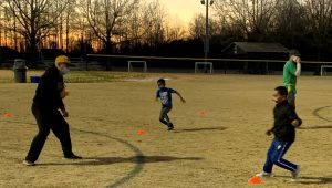 Youth practicing sports at dusk