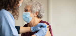 Woman receiving COVID-19 vaccine