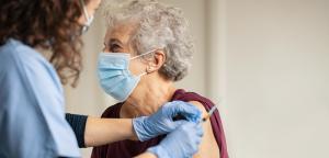 Woman receiving COVID-19 vaccine