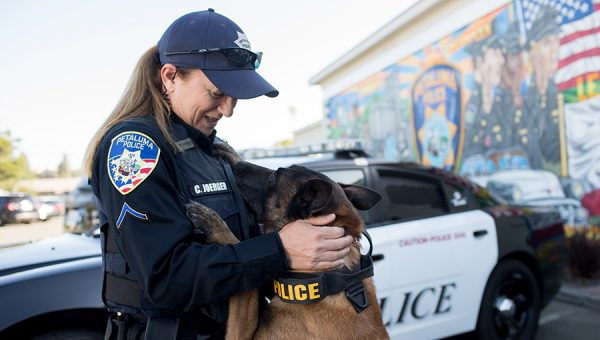 photo of police officer with police dog