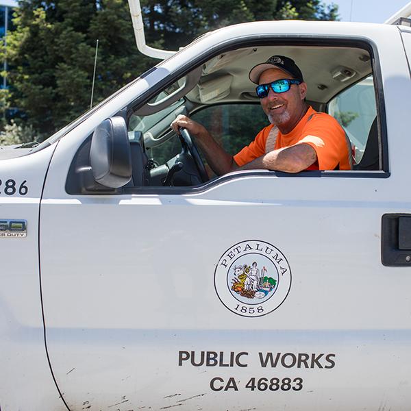 photo of public works employee in truck