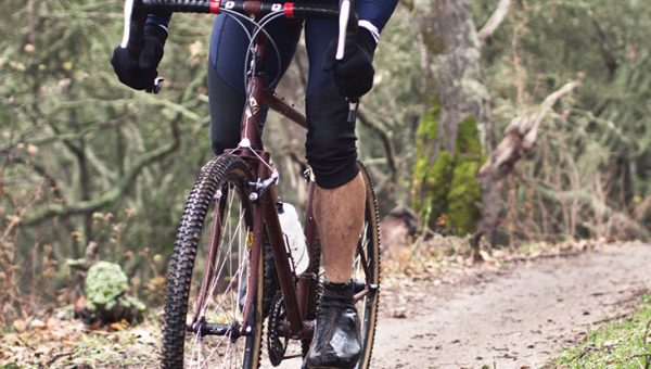 photo of someone biking in the trails