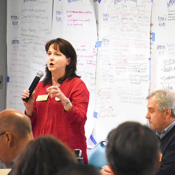 photo of woman speaking at workshop