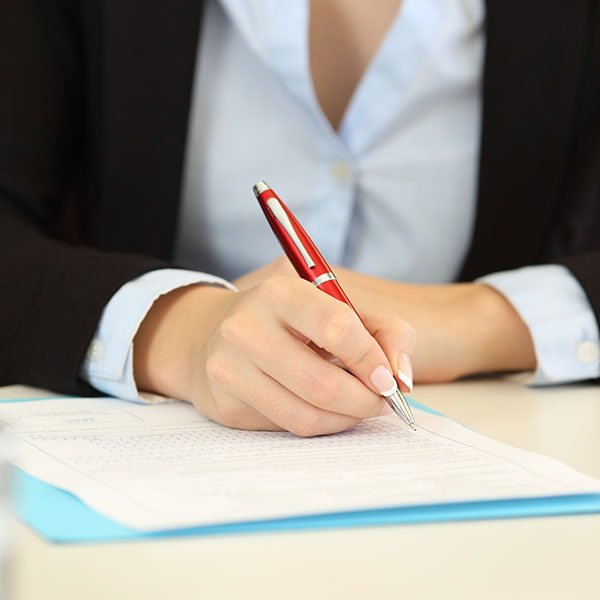 photo of person with pen and paper