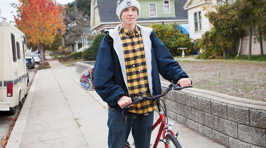 young man with a bicycle
