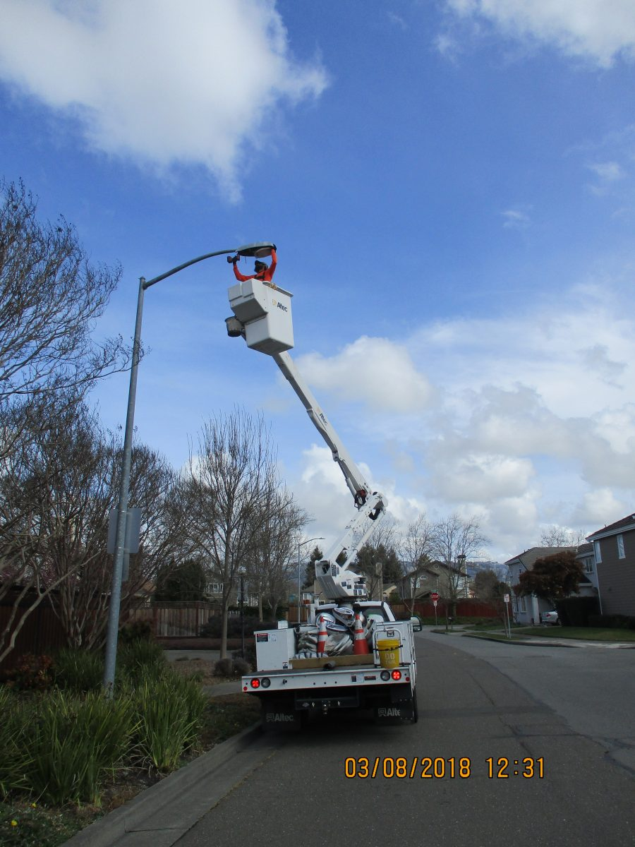 person installing a new light
