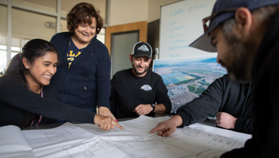 photo of conservation team looking at map