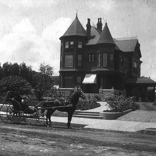 brown house with carriage