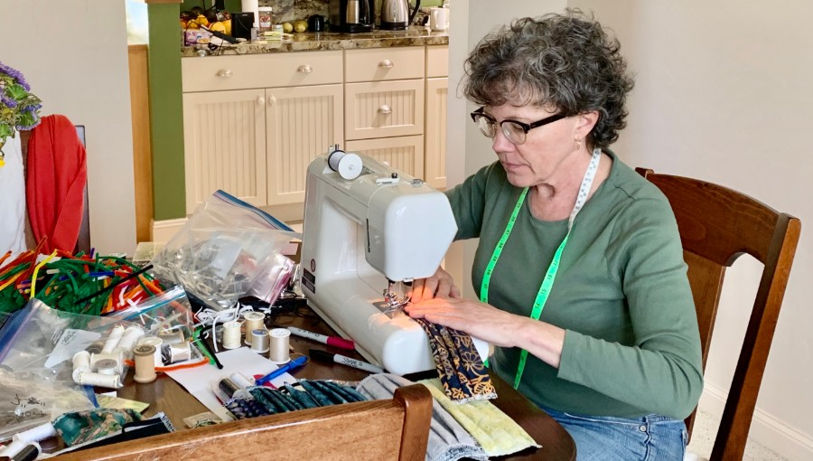 KC Greaney at her sewing machine