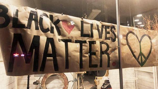 black lives matter sign in storefront