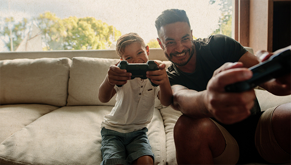 picture of father and son playing video game