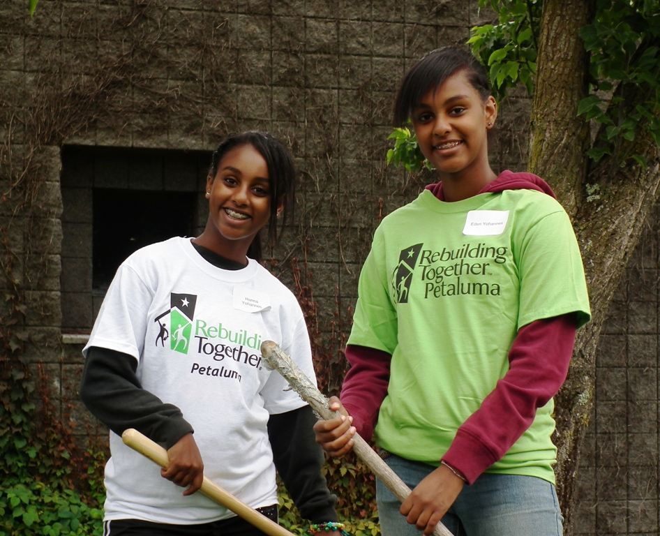 girls with rebuilding together tee shirts