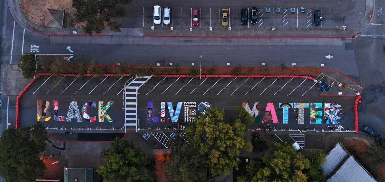 "street mural spelling out ""black lives matter"""