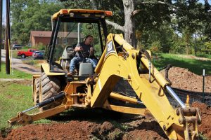 Keith Ward using heavy equipment