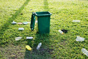 plastic bottles on the grass