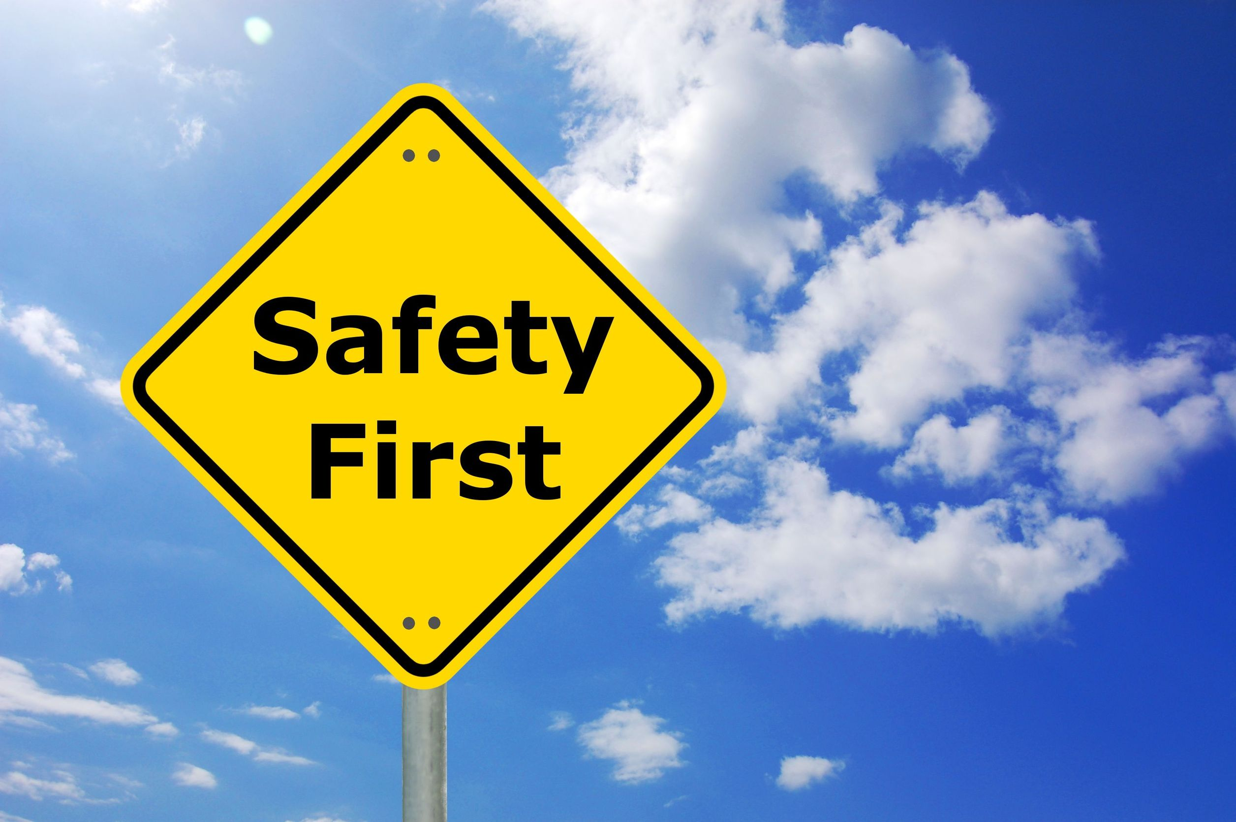 safety tips sign with blue skies background