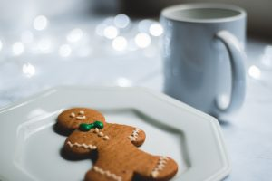Ginger bread laying on train with cup with warm drink