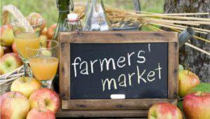 farmers' market sign on chalk board