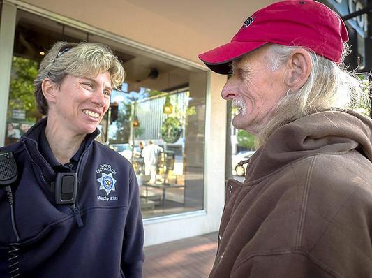 Lynn spends at least half of her day walking around downtown connecting with people in need. Here she is chatting with Ricky, a long-time homeless resident of San Rafael, in front of Starbucks.