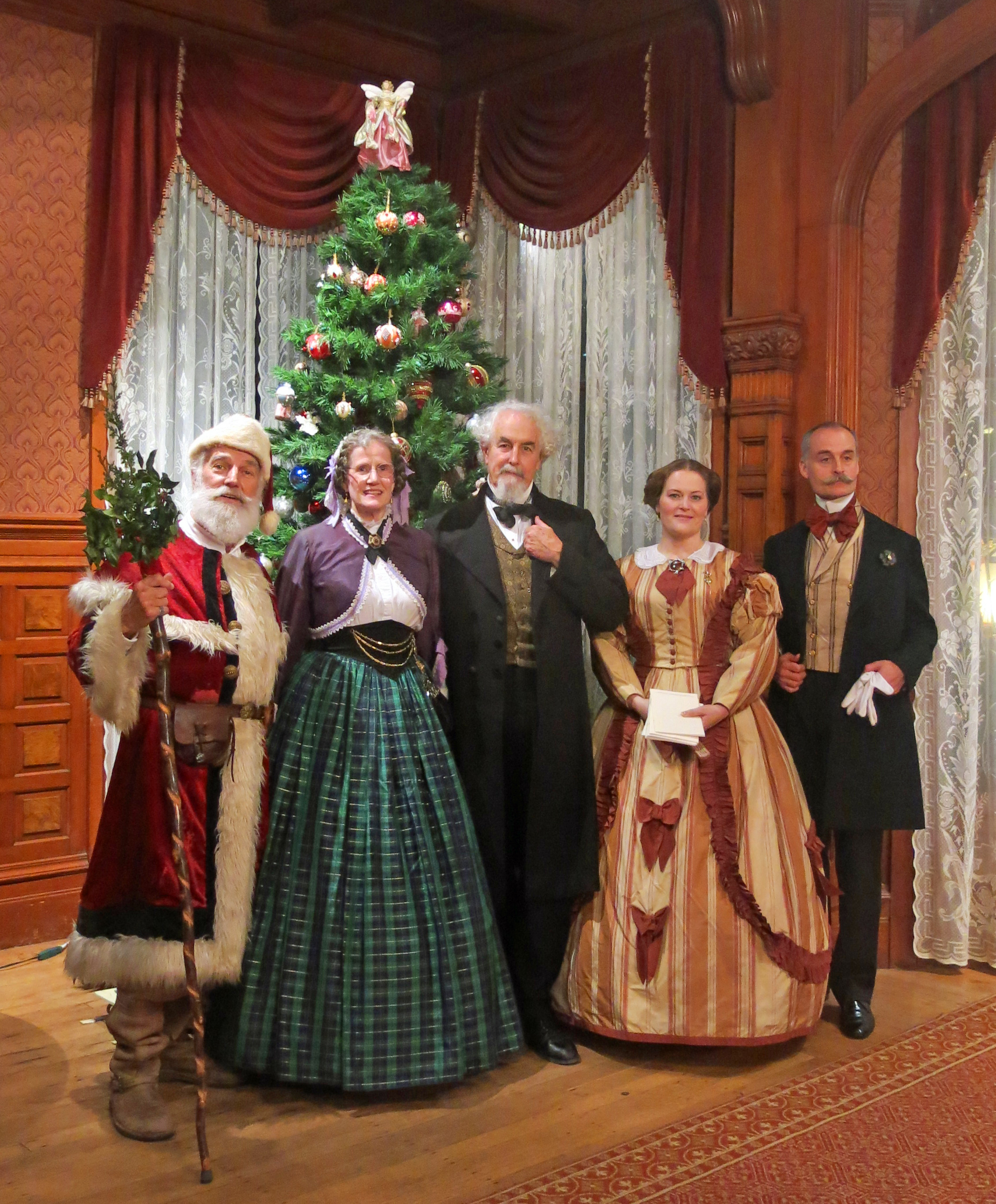 Dickens group posing in front of a christmas tree in Falkirk Cultural Center