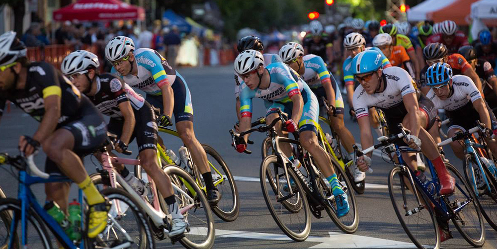 Cyclists compete in the Sunset Criterium bike race in Downtown San Rafael