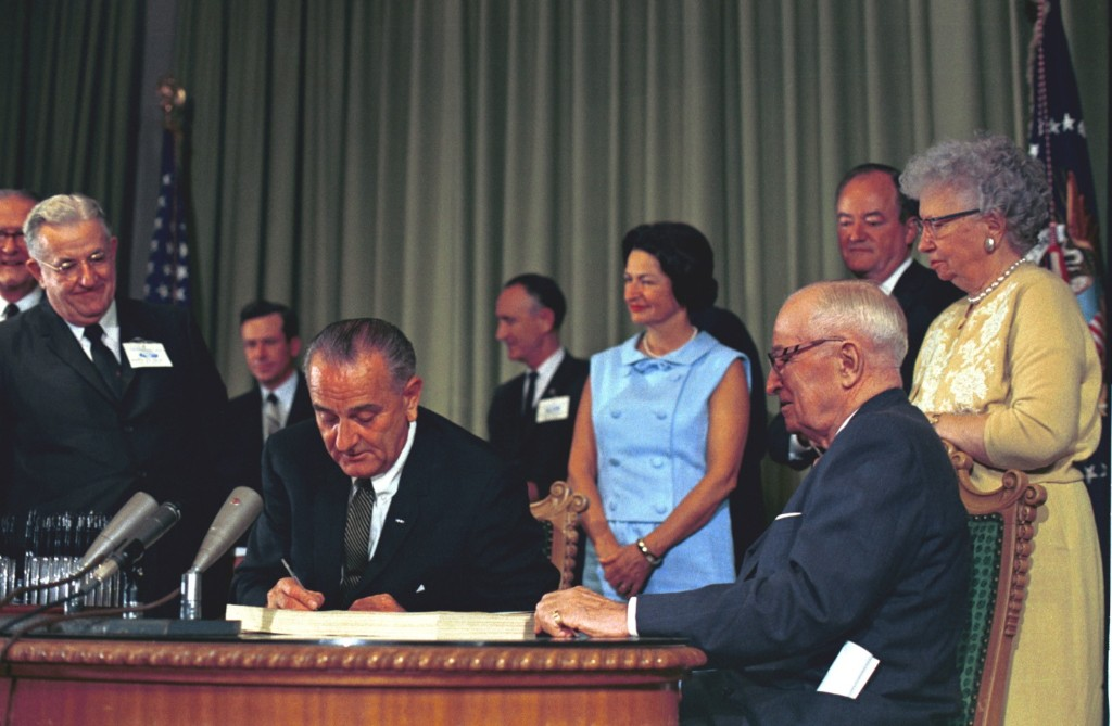 LBJ signing Medicare into law