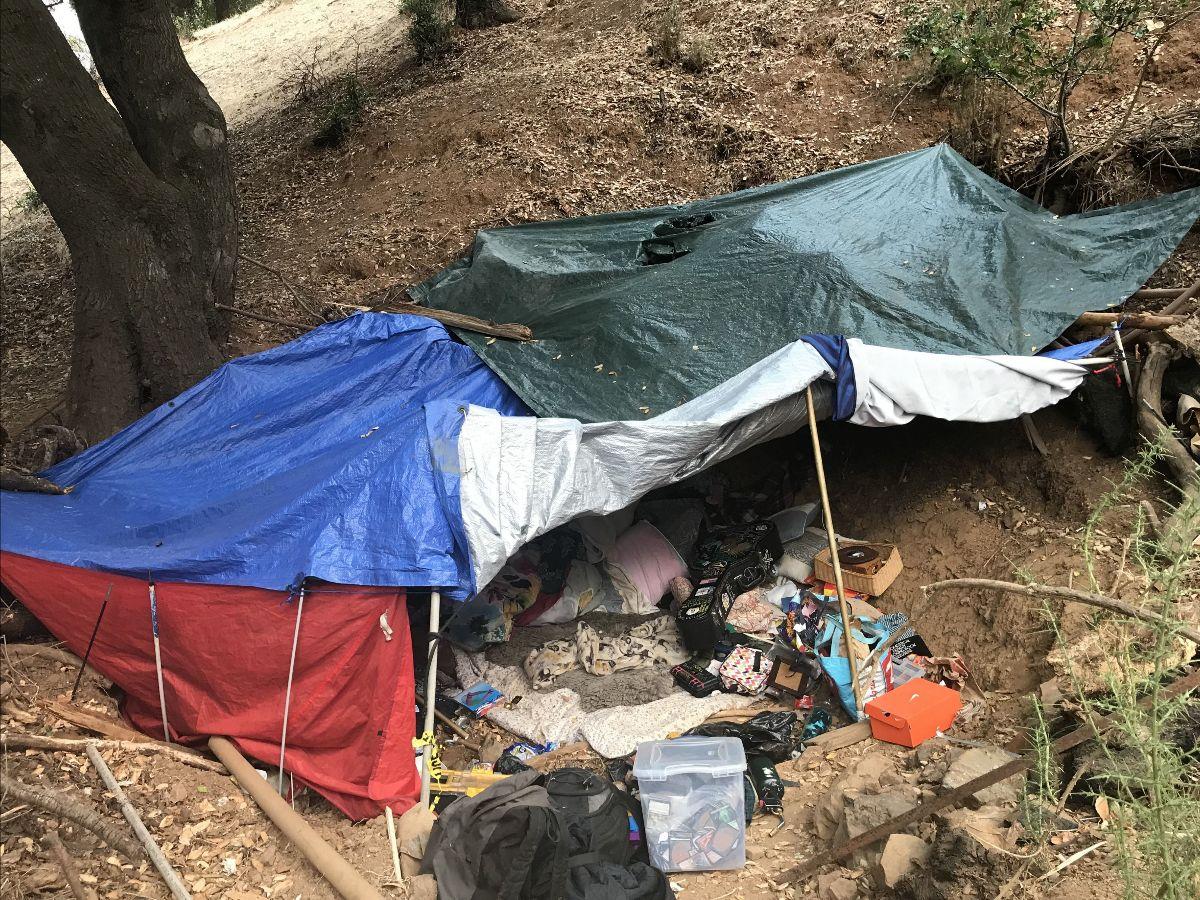 Hillside encampment with fire starter
