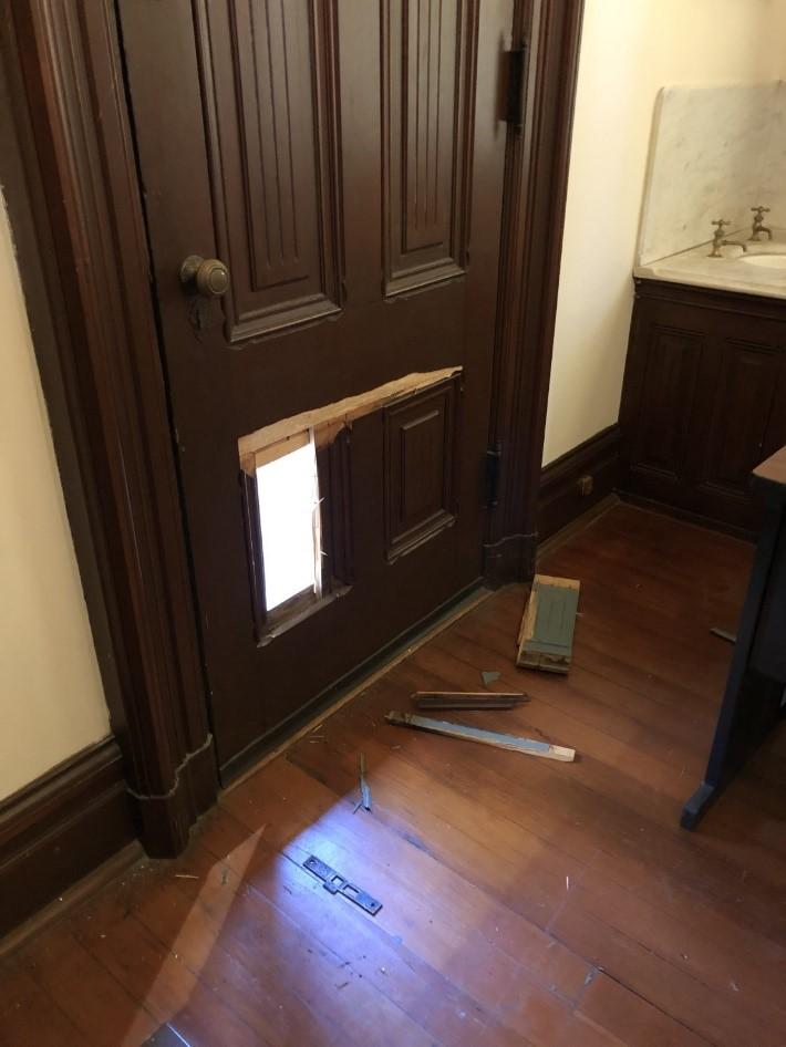 Boyd Gate house door damage