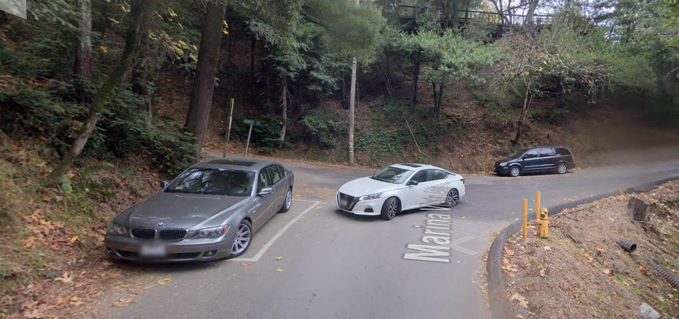 Google street view of parking boxes on narrow hill streets