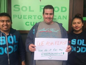 Sol Food employees with Ask First sign