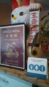 Uncle Wing Menu and We Ask Sign