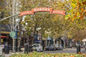 Historic Murphy Avenue sign with businesses in background