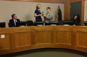 Former Mayor Madolyn Agrimonti hands New Mayor Amy Harrington a gavel
