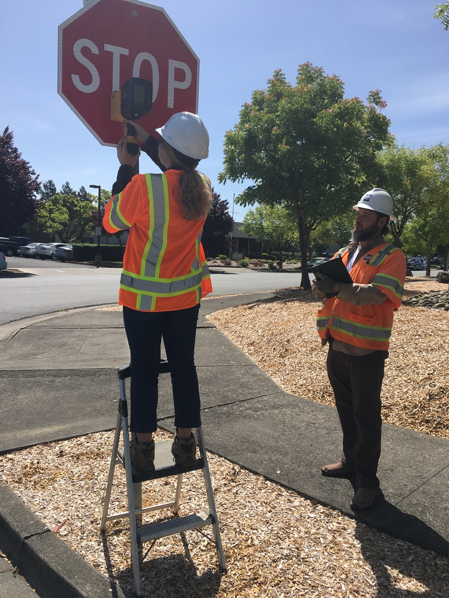 GHD staff conducting an assessment of road signs.