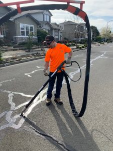 Streets Maintenance Worker Edy Mendoza using the City's new crack sealer equipment as part of the City's Pavement Maintenance Program.