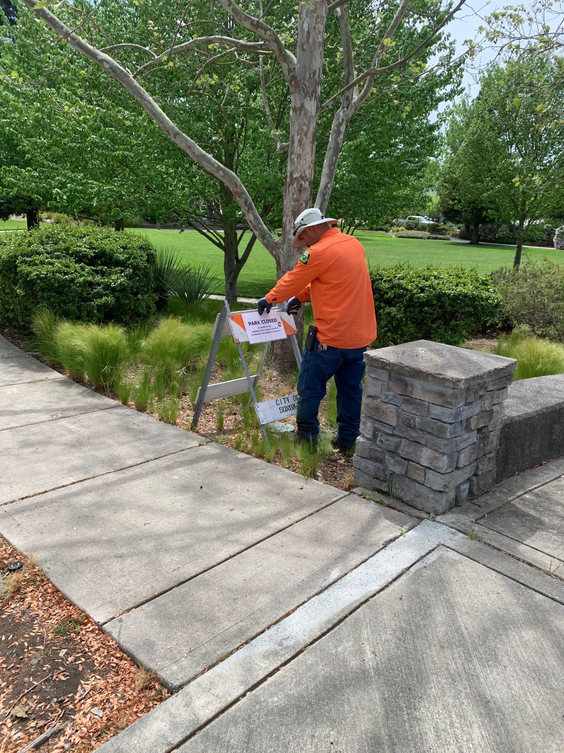 Public Works Employee Tom Arrington Puts up New Signage at Engler Park.