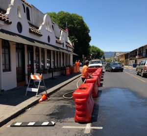 public works staff fill up water barriers