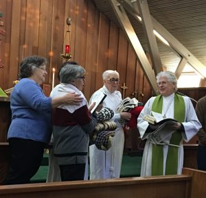 Having the shawls blessed during Sunday service. L to R: Susie Hand, Norah Collins (holding shawls), Linda Dowd, Fr. Jim Thomas, Priest-in-charge, Trinity Episcopal Church, Sonoma, CA
