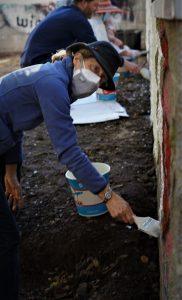 Nancy Evers Kirwan helps with graffiti abatement in Mountain Cemetery
