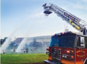 Firefighters cool off local kids on a hot summer day