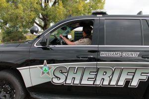 Female deputy in patrol SUV
