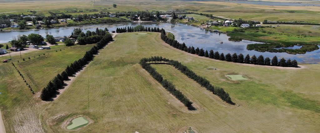 Aerial view of several holes of the Blacktail Dam Golf Course